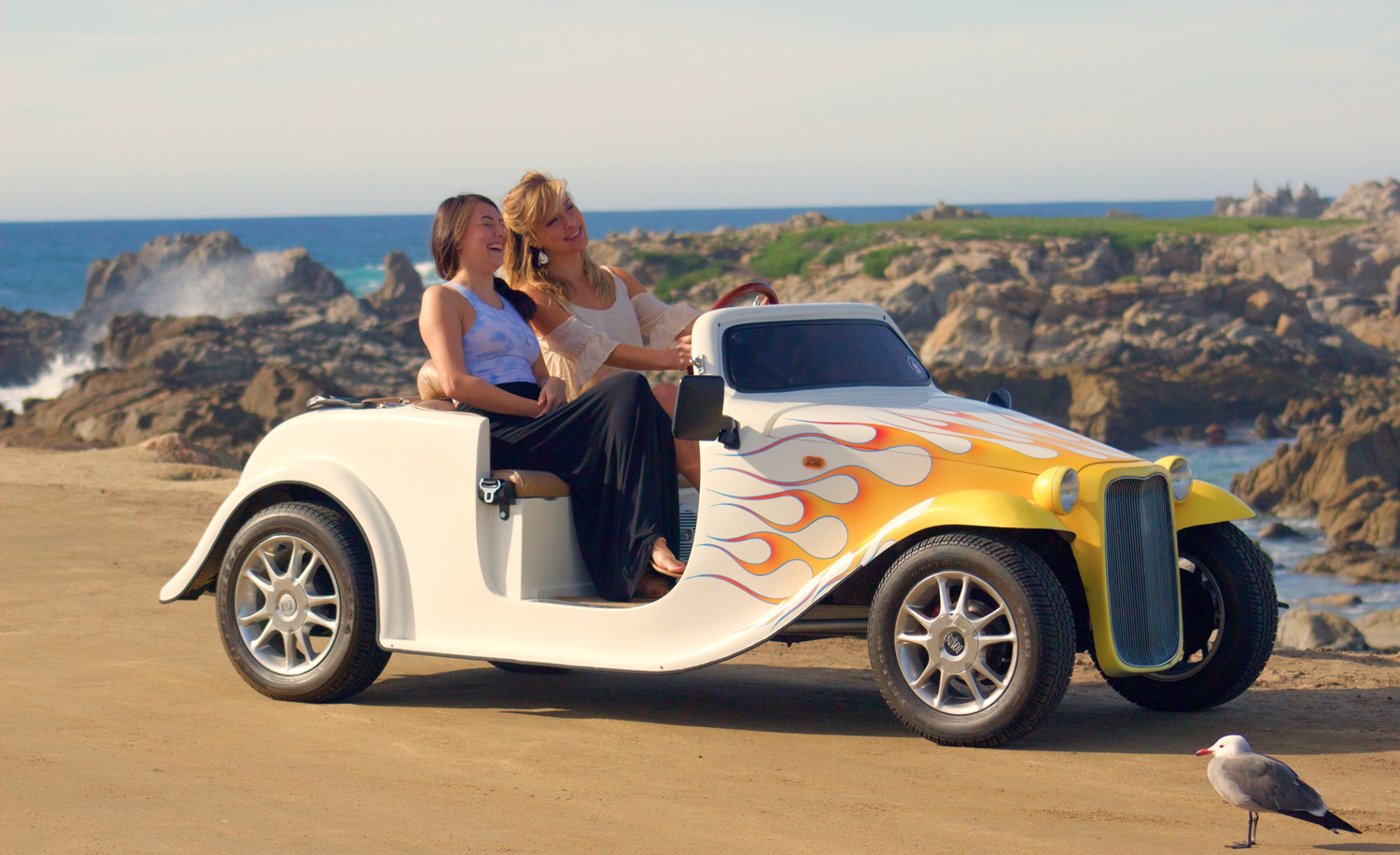 laughing in a sea car roadster